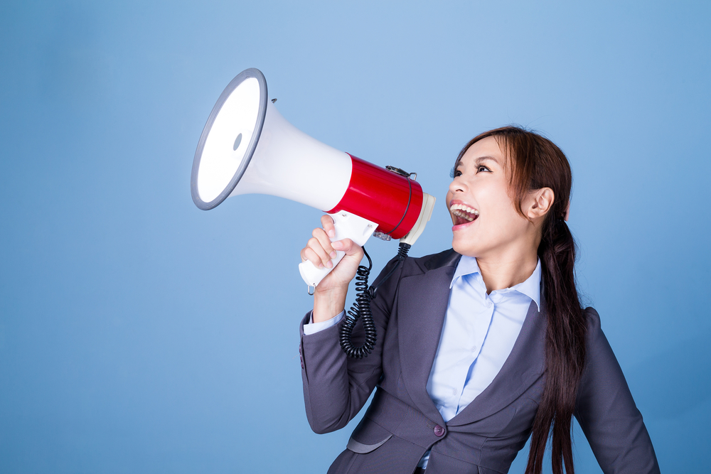 Ouitbound marketing - Businesswoman making announcement with megaphone